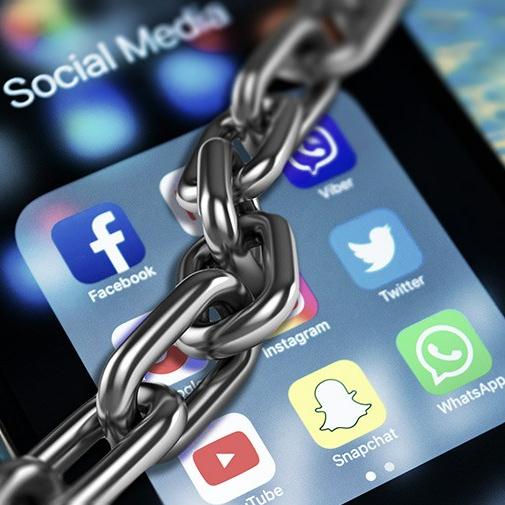 chained-social-media-facebook-twitter-youtube-regulations-internet-900.jpg